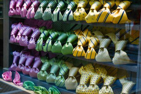 Gradual colors of elegant ties exposed in the shop window