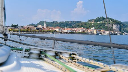 Panorama of the small town from a boat on Lake Maggiore in northern Italy 스톡 콘텐츠