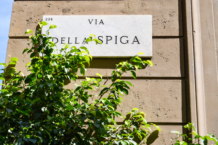 Municipal marble plaque engraved with the writing of via della Spiga of Milan in Italy Editorial