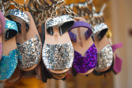 Different colors of glittery shoes symbol of Menorca one of the Spanish islands