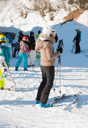 Single woman skier at the end of a snow-covered ski slope