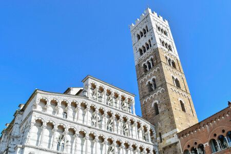 High part of the main Christian cathedral with arches and tower in Lucca in central Italy 스톡 콘텐츠