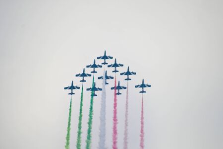 Ten old Frecce Tricolori in the air during a day with a little fog