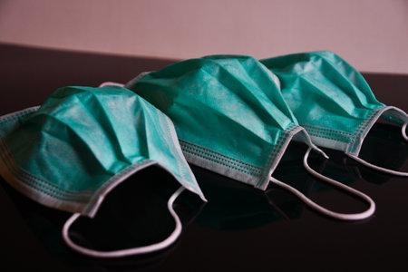 Green antivirus masks on black and white background 스톡 콘텐츠