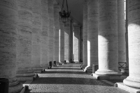 Portico with huge white marble columns of Cathedral of San Pietro  square without visitors - Christianity and Pope 스톡 콘텐츠