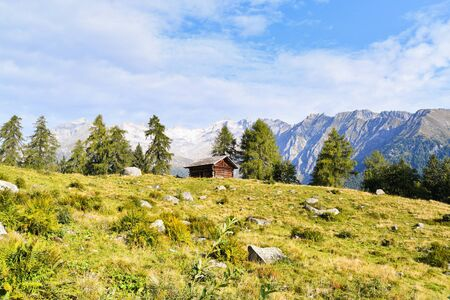 Wooden walled cottage with heavenly views of the Adamello Glacier 스톡 콘텐츠