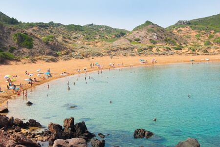 Panorama on the red sand of the wide de Cavalleria bay of the spanish island Minorca Banco de Imagens
