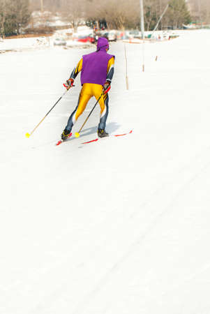 Boy dressed in technical attire during mountain ski race