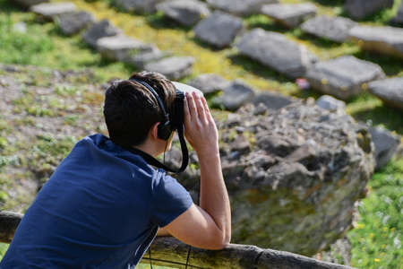 Person observing the ruins of the Circo Massimo wearing a 360 virtual tour mask