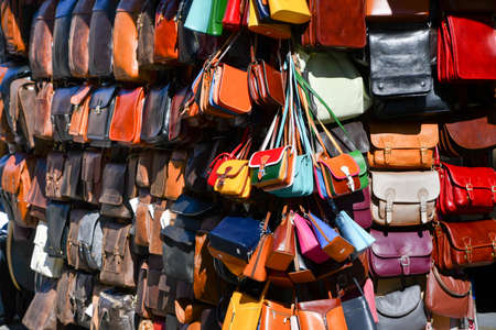 Many different kind of bags for women and men displayed outside of a shop