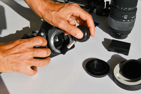 Photography instruments as camera body and lens and SD cards and photographic stand and ND filter on a white background