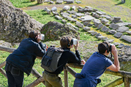 Three tourists with virtual reality mask while visiting the city of Rome in Italy - Circus Maximus 스톡 콘텐츠