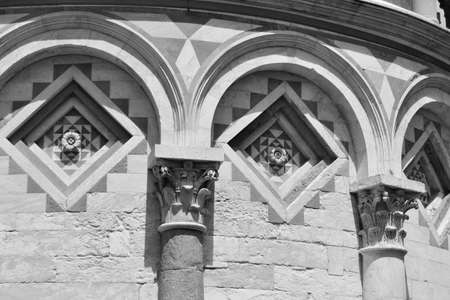 Geometric decorations with arches lines and Corinthian capitals of the famous Tuscan tower