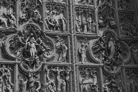 Story of Jesus represented on the main door of the Milan Cathedral in Italy