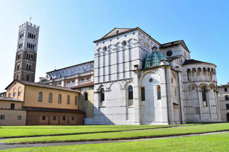 Back side of Cathedral with tower during a sunny day. Lucca a small town next to Pisa 스톡 콘텐츠