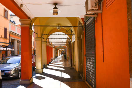 Glimpse of a street with a characteristic arcade of Bologna a city in the north of Italy 에디토리얼