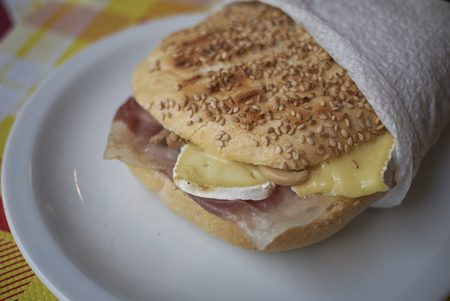 Sandwich with ham and brie