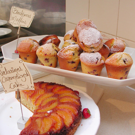 London, United Kingdom - February 24, 2001: Muffins and nectarine cake