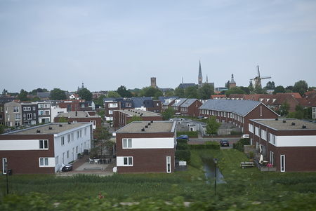 Netherlands - May 16, 2018 : View of Netherlands countryside by a trian window from Eindhoven to Amsterdam