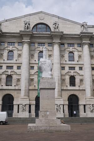 Milan, Italy - July 12, 2018 : View of Palazzo della Borsa and Maurizio Catellan sculpture L.O.V.E. Editorial