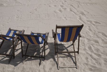Mondello, Italy - September 10, 2018 : Striped sunchairs on the beach Stock Photo