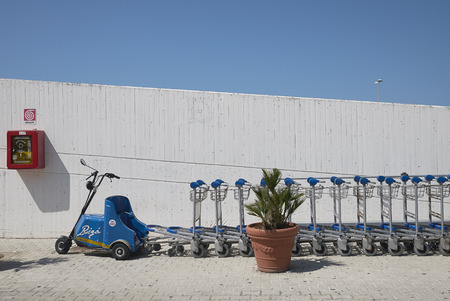 Palermo, Italy - August 31, 2018 : trolleys at Palermo Airport Archivio Fotografico - 119314637