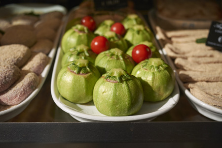 Stuffed courgettes on a layer