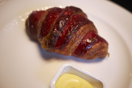 Croissant with butter Stock Photo