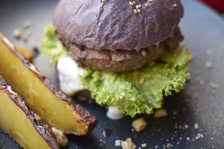 Hamburger sandwich with roasted potatoes Stock Photo