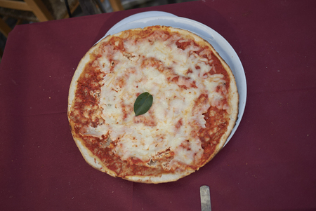 Pizza margherita on a table Stock Photo