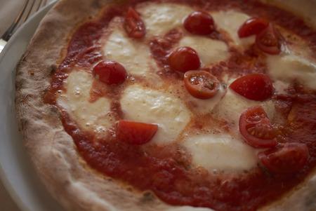 Pizza with buffalo mozzarella and cherry tomatoes