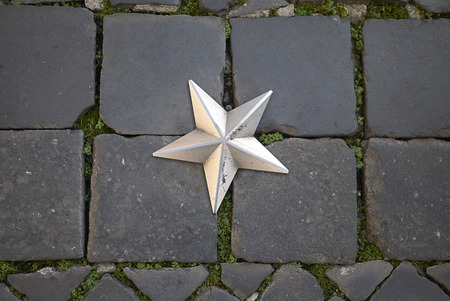 Roma, Italy - February 09, 2019 : Silver star in the pavement