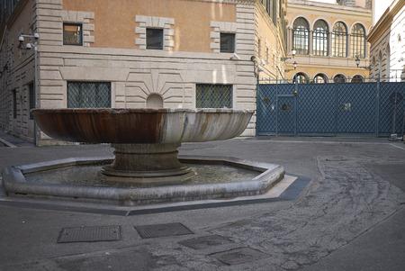 Roma, Italy - February 09, 2019 : Stadeari street fountain probably from the Baths of Nero