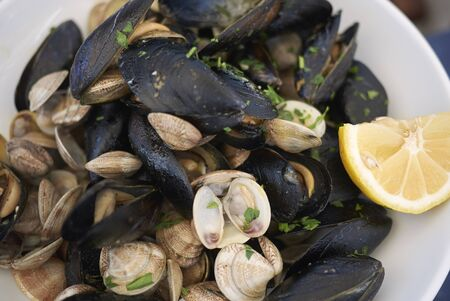 Mussels and clams with lemon, garlic and parsley Stock fotó