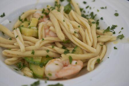 Strozzapreti pasta with zucchini and shrimps