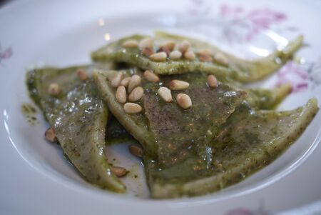 Testaroli pasta with pesto and pine nuts 版權商用圖片
