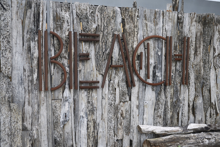 Milano Marittima, Italy -  July 28, 2019 : Rustic beach sign on a wood wall 報道画像