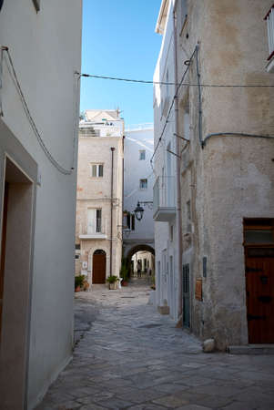 Monopoli, Italy - September 04, 2020: View of the old city center narrow street