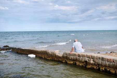 Lido Morelli, Italy - September 03, 2020: Man resting by the sea Editorial