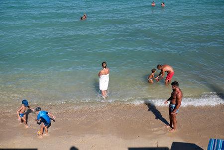 Monopoli, Italy - September 04, 2020: Tourists at Cala di Porta Vecchia beach