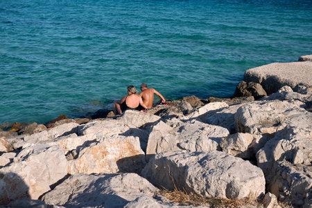 Campomarino, Italy - September 06, 2020: Couple on the rocks