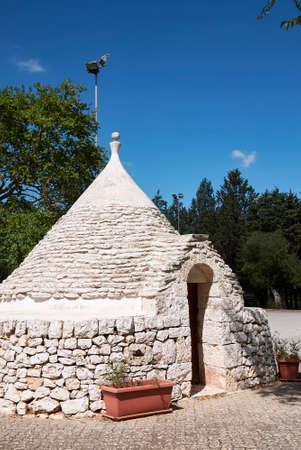 Castellana Grotte, Italy - September 04, 2020: View of a trullo