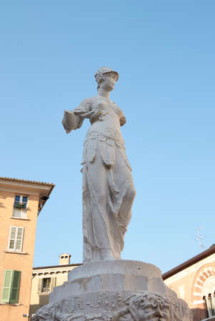 Brescia, Italy - August 22, 2020: Minerva statues in the cathedral square