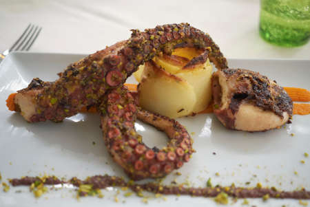 Grilled octupus with potato and pistachios