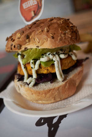 Vegetarian burger with red cabbage and lime mayo