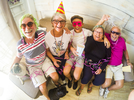 group of two senior couples and young boy havig fun at home Foto de archivo