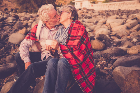 senior couple 70 years in love kissing on the beach in Tenerife