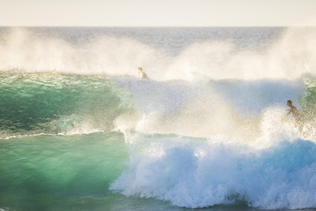 Big swell wave with white foam high energy impact perfect for surf and body board activity - danger with the ocean water - tropical place for vacation concept with blue sea