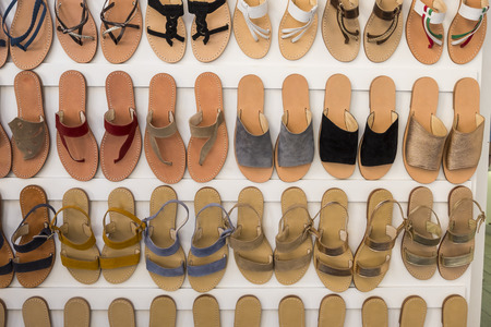 Shoes for a young woman, for daily summer use shown in a shop with huge variety of colors and model totally handmade by artisans