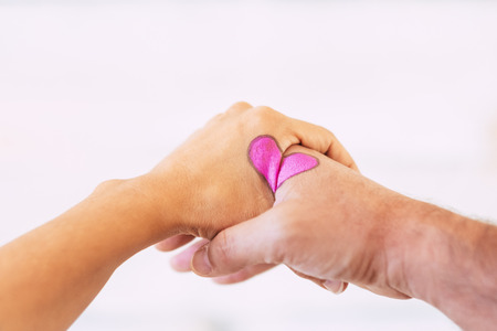 Valentine's day heart concept designed on couple aged hands - white studio background and love forever pict